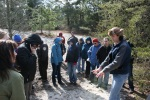 Conference participants listen to Jason Beale, manager of Abbott's Mill Nature Center, during a dune nature walk.